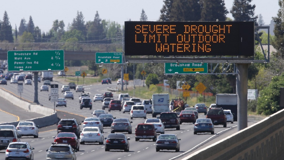Motorists in Rancho Cordova, California, pass a sign in April reminding them to reduce water use.