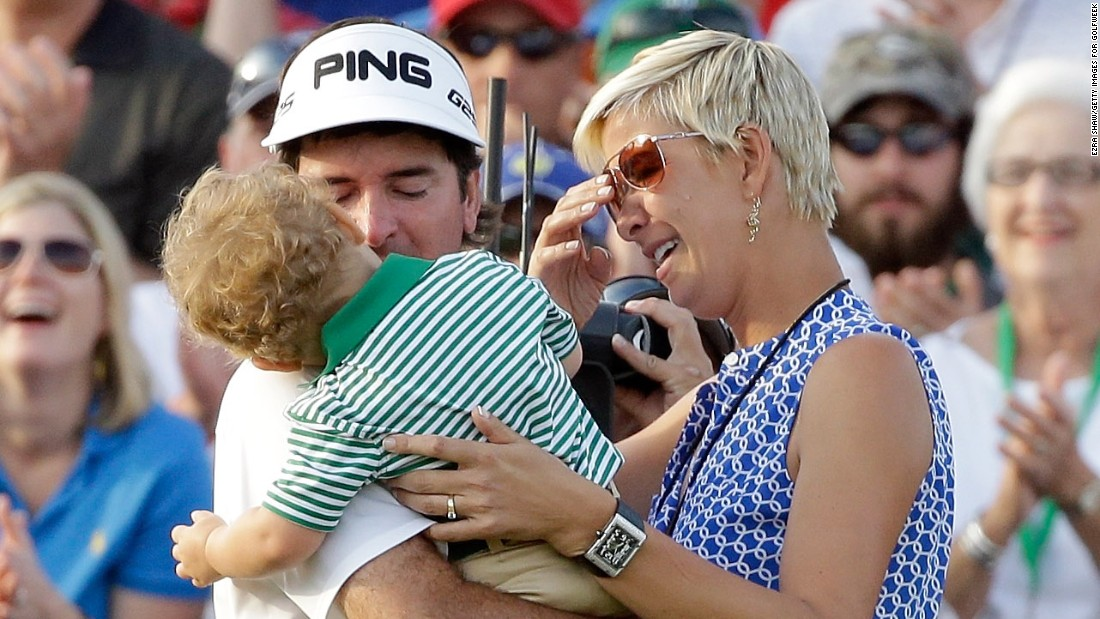 Watson celebrated with wife Angie, who used to be a pro basketball player, and young son Caleb.