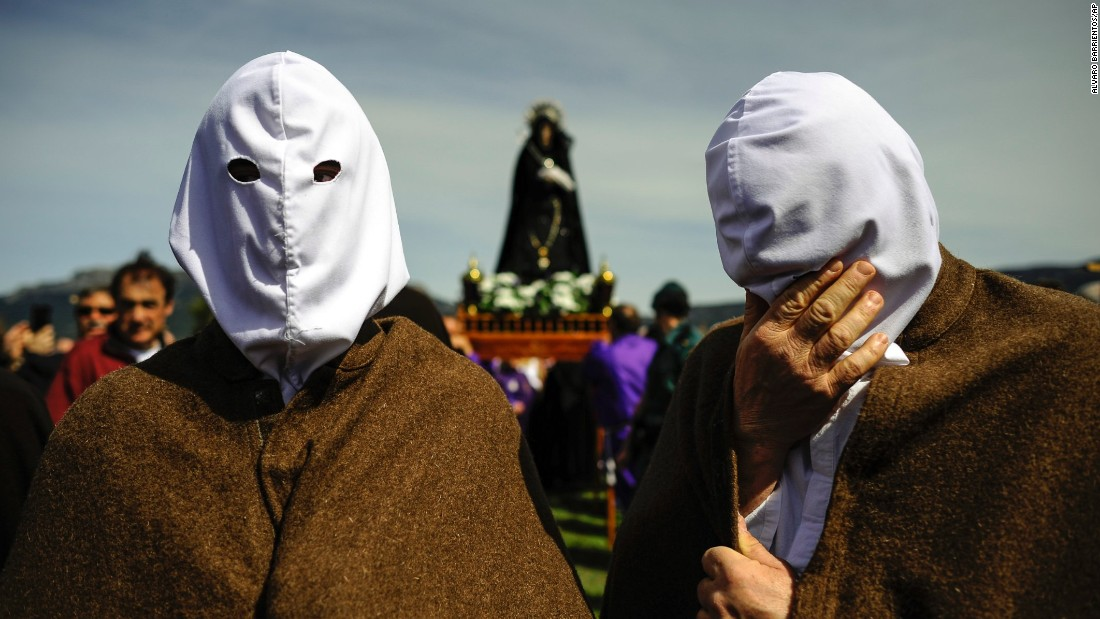 A masked penitent from La Santa Vera Cruz brotherhood takes part in an Easter procession known as Los Picaos in the small Spanish village of San Vicente de la Sonsierra on April 3.