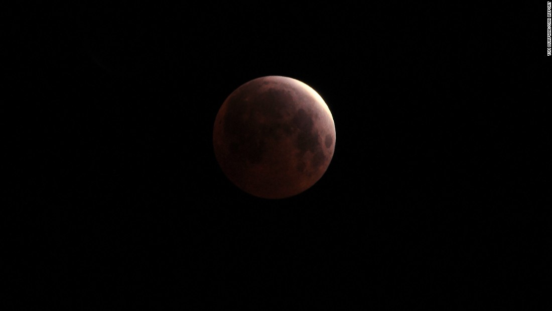 "A glowing blood moon is seen from <a href=""http://ireport.cnn.com/docs/DOC-1230915"">San Clemente, California</a>, in the early morning hours of April 4."