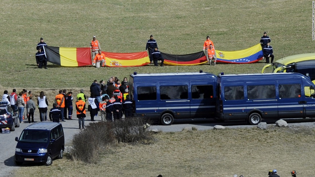 "Relatives of the <a href=""http://www.cnn.com/2015/03/24/world/gallery/france-plane-crash/index.html"" target=""_blank"">Germanwings Flight 9525</a> crash victims arrive on Saturday, April 4, at a ceremony as rescuers hold flags of the late passengers' nationalities in the village of Le Vernet. Flight 9525 was carrying 150 people when it crashed in the French Alps in March. It was traveling from Barcelona, Spain, to Dusseldorf, Germany."
