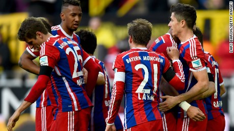 Robert Lewandowksi (right) is congratulated by his Bayern Munich teammates after scoring against Borussia Dortmund.