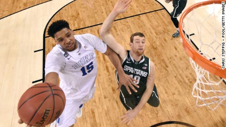 Duke's Jahlil Okafor drives for the Michigan State basket in the first half.
