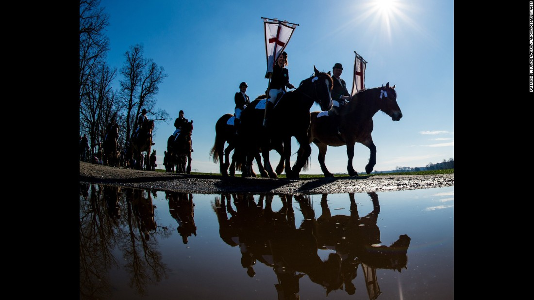 Easter horsemen ride near Luebbenau, Germany, on April 5.  In the Sorbian residential areas of Lusatia, it's an annual tradition for horsemen wearing festive attire to join the traditional Easter procession to announce the resurrection of Jesus Christ in the neighboring towns with prayers and songs.