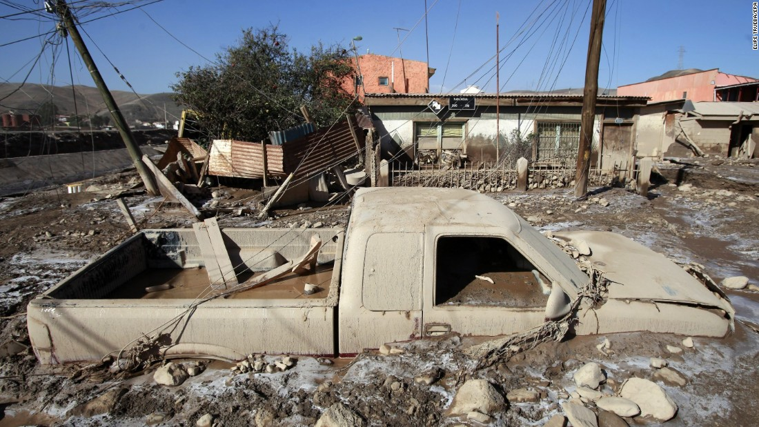 A pickup truck sits encased in mud in Diego de Almagro on March 28.