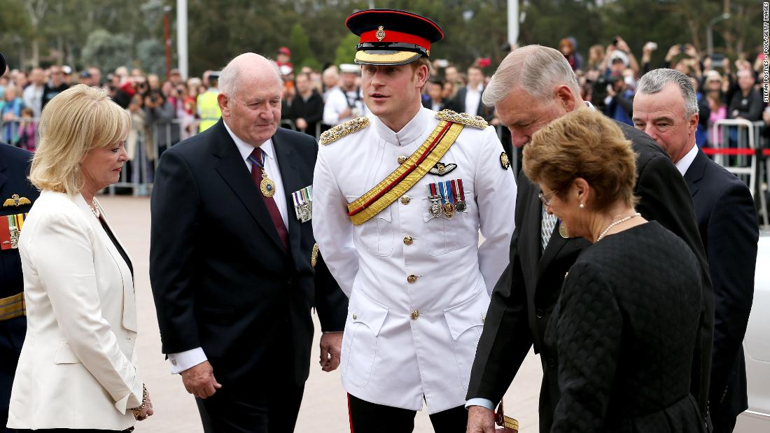 Prince Harry is greeted by Governor-General Sir Peter Cosgrove, second left,  and Chairman of the Council of the War Memorial Ken Doolan, third right, during a visit to the Australian War Memorial on Monday, April 6, in Canberra, Australia. Prince Harry, or Captain Wales as he is known in the British Army, will end his military career with a monthlong secondment, or temporary assignment, to the Australian Defence Force in barracks in Sydney, Perth and Darwin.