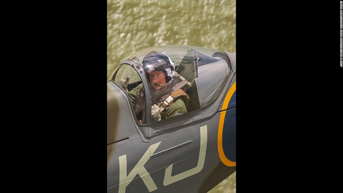 Prince Harry flies in the back of a Spitfire on a sortie from Goodwood, West Sussex, via the Isle of Wight in this undated photo released April 5.
