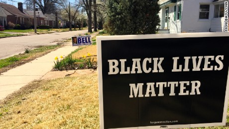Wesley Bell's sign shares space with a common slogan in Ferguson.