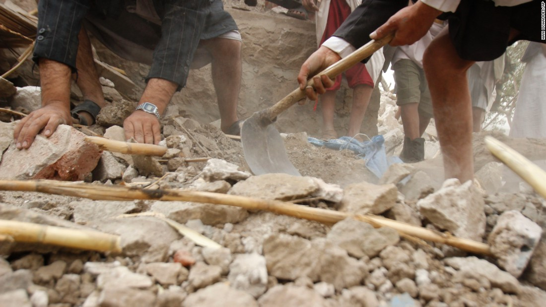 Yemenis search for survivors in the rubble of houses destroyed by Saudi-led airstrikes on April 4 in a village near Sanaa.