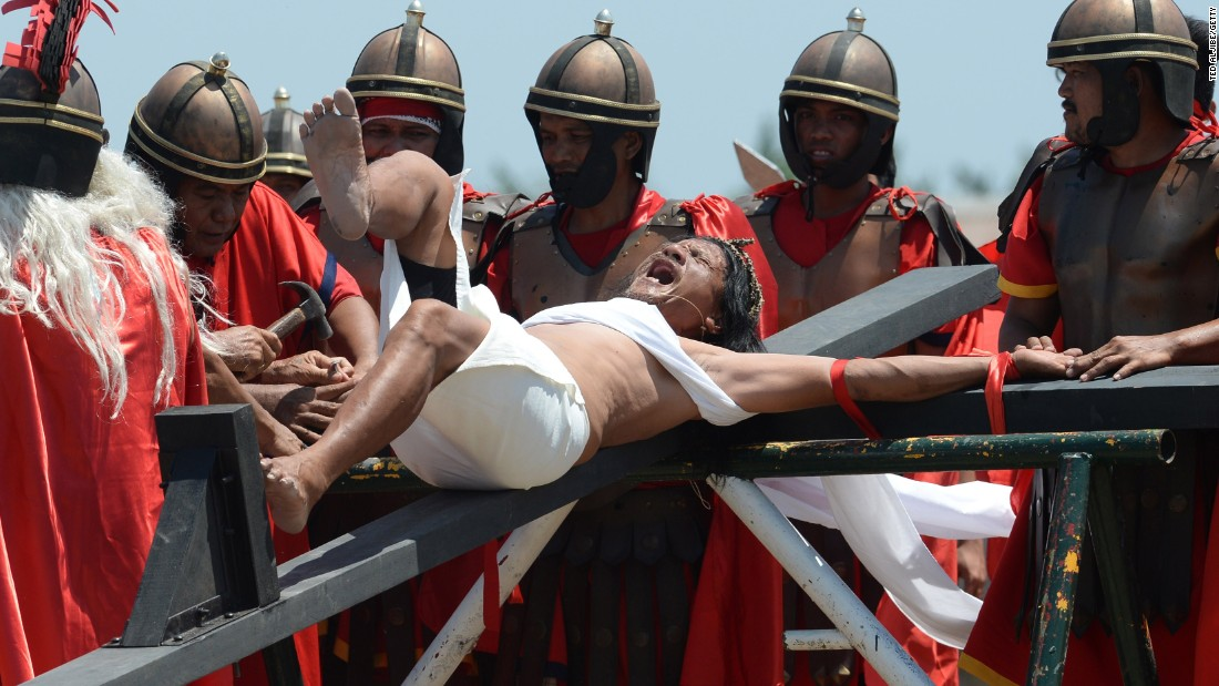 Not for the weak of heart: Penitent Ruben Enage wails in pain as he is nailed to a cross by devotees wearing costumes of Roman centurions in the village of Cutud, Philippines on April 3, 2015.