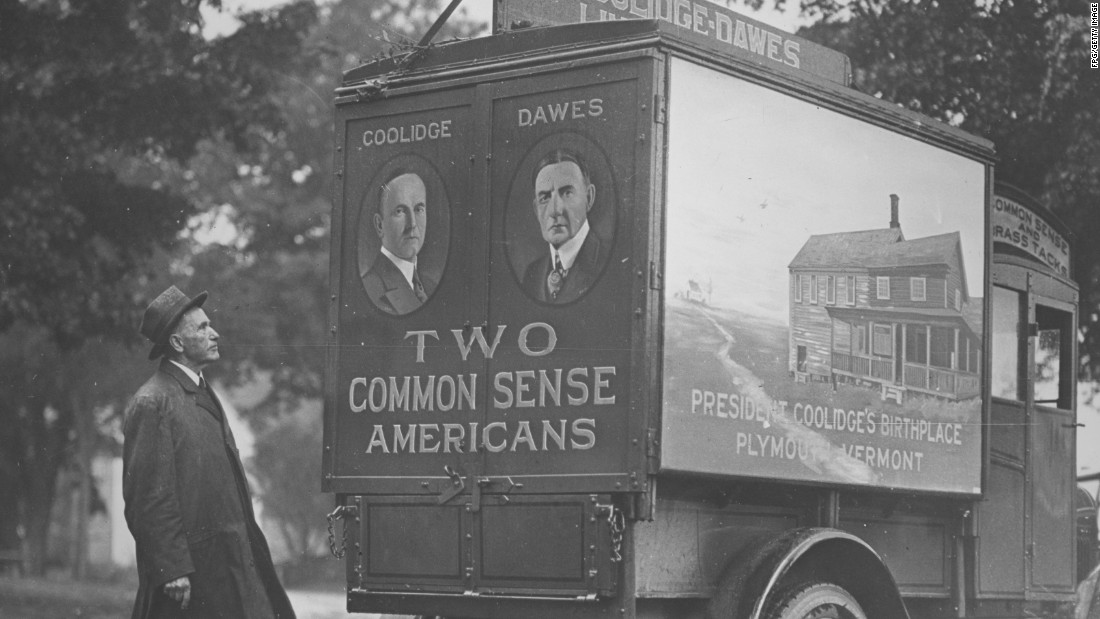 "Calvin Coolidge inspects a campaign truck painted with images of Coolidge and his running mate, Coolidge's birthplace in Plymouth, Vermont, and the campaign slogan, ""Two common sense Americans,"" circa 1929."