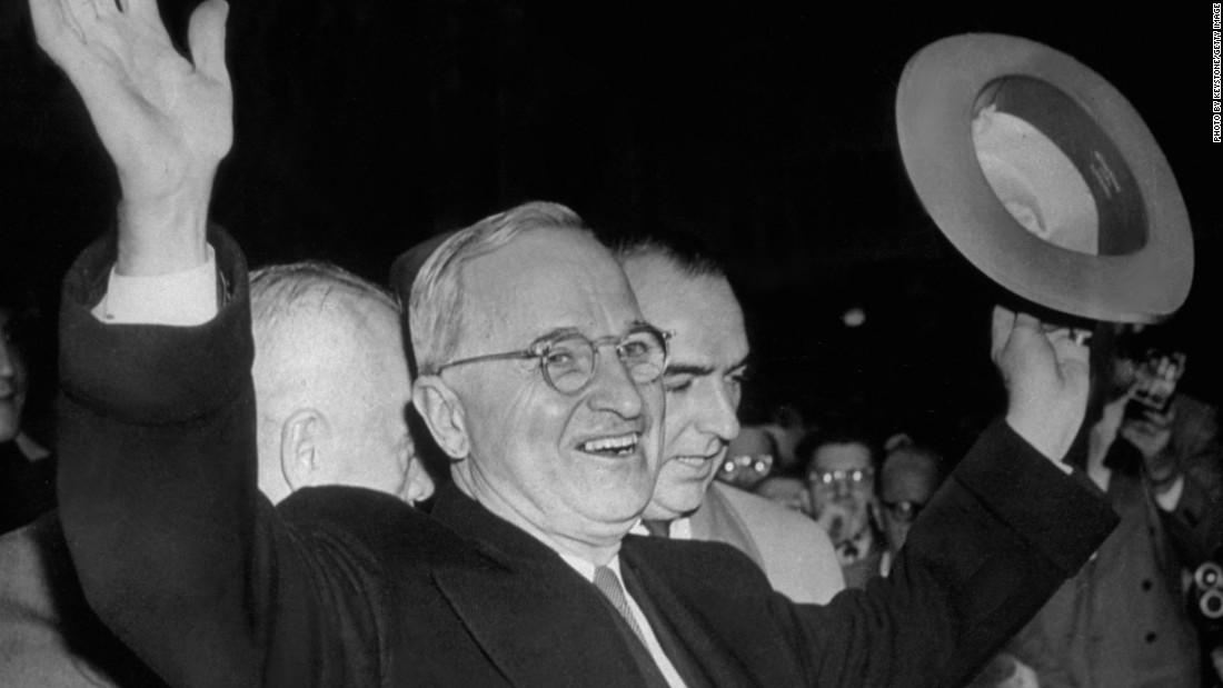 "President Harry S Truman smiles and waves to the excited Kansas City crowd after hearing the news that he had won the election to retain the presidency in 1948. Truman famously adopted the slogan ""Give 'em Hell, Harry!"" after a supporter yelled the phrase during a campaign event."