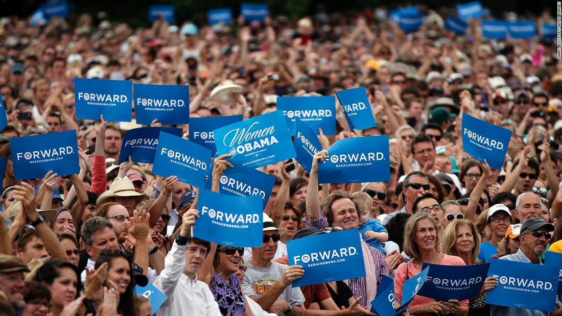 "Supporters cheer and wave ""Forward"" signs as President Barack Obama speaks at a rally on September 2, 2012, in Boulder, Colorado."