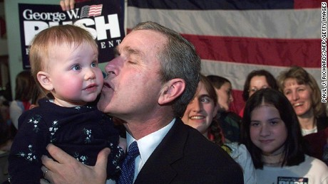 "Republican presidential hopeful, Texas Governor George W. Bush ran as a ""compassionate conservative,"" which became a popular slogan during his campaign. During a campaign rally on February 7, 2000, in Wilmington, Delaware, Bush kisses Abigail Houseal."