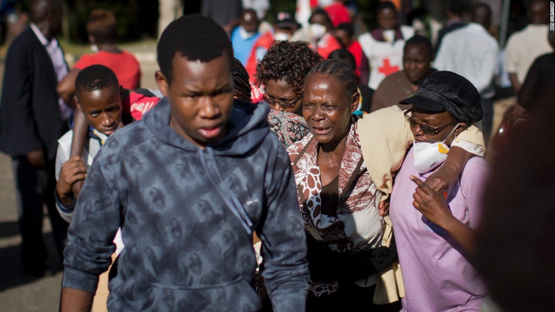 A relative grieves after identifying a body at a funeral home in Nairobi, Kenya, on April 6, 2015. Several days earlier, gunmen stormed Garissa University College in Garissa, Kenya, and killed at least 147 people. The Somalia-based Al-Shabaab militant group claimed responsibility for the assault.