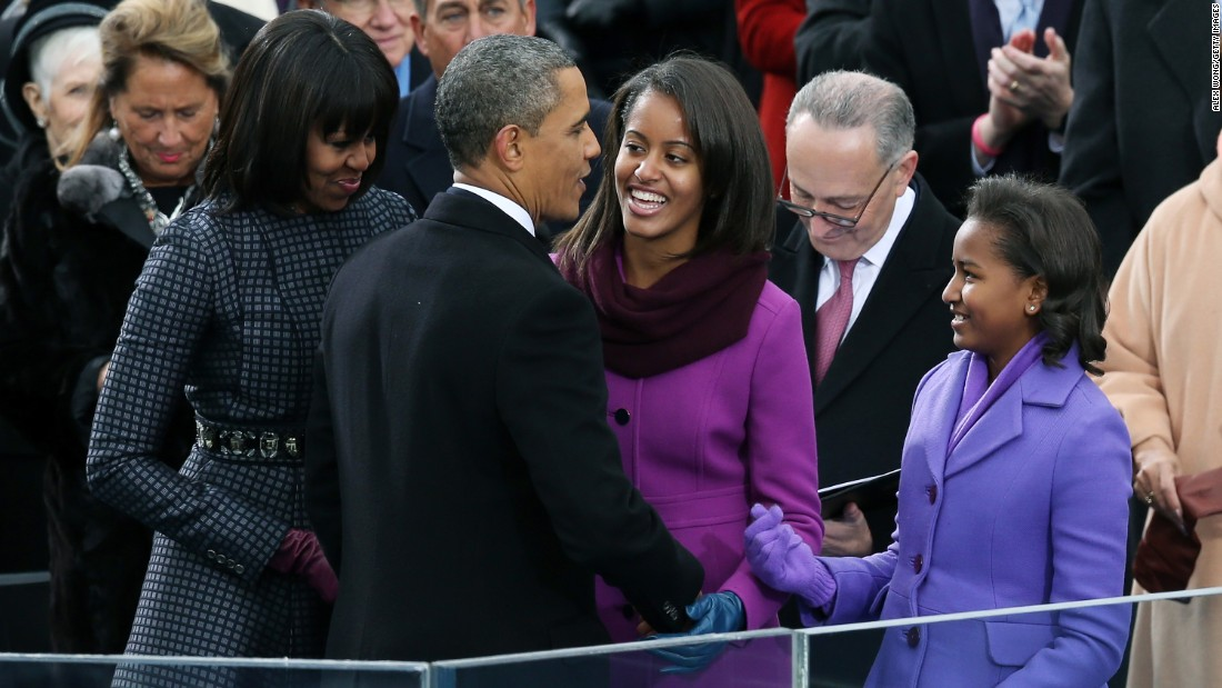 President Obama greets his wife and daughters after being sworn in for his second term in January 2013.