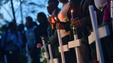 People hold candles alongside wooden crosses at Freedom-Corner in Uhuru Park in Nairobi on April 7, 2015 during a candlelight vigil for the victims of an attack claimed by Somalia's Al-Qaeda-linked Shebab insurgents on a university campus in Kenya's nothern town of Garissa, in which 148 people were killed. Hundreds of Kenyans took to the streets on April 7 demanding greater security following last week's massacre by Somalia's Shebab Islamists, on the final day of mourning for the 148 people killed by the militants. AFP PHOTO / TONY KARUMBATONY KARUMBA/AFP/Getty Images