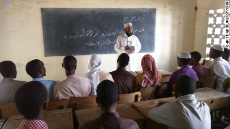Sheikh Khalif Abdi Hussein teaches a class at the Madrassa, where Mohamed Mohamud once taught.