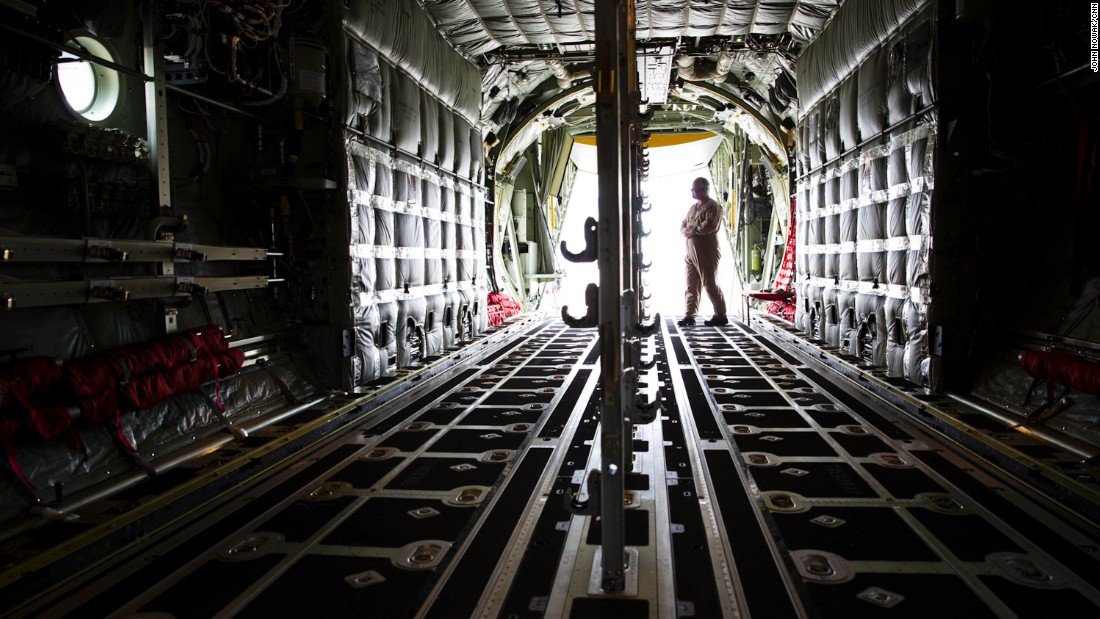 Lockheed loadmaster Lucky Madsen stands inside the cargo hold of the MC-130J. The floor can be quickly and easily converted from a flat surface to a floor embedded with rollers. The rollers allow cargo to be easily moved and unloaded from the plane.