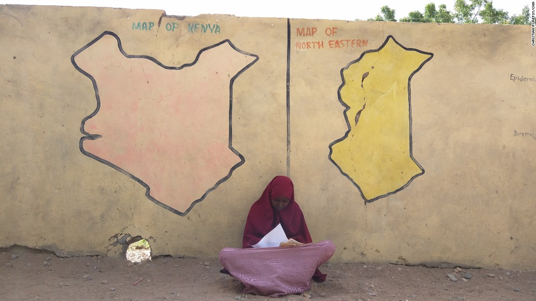 "A young girl studies for class at the Ibnu-Siina school in Garissa, Kenya. The school is located only a few hundred meters from <a href=""http://cnn.com/2015/04/08/africa/kenya-garissa-attack-madrassa-purefoy/index.html"">Garissa University, where 147 people were killed</a> by Al-Shabaab terrorists in early April."