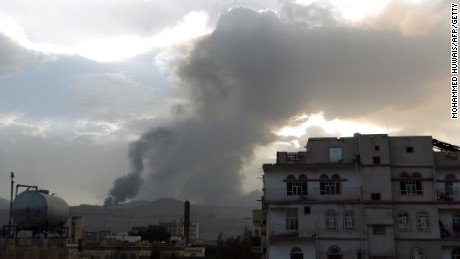 Caption:Smoke and flames rise allegedly from Shiite Huthi rebels camps located on Faj Attan Hill and Aser mountain following an airstrike by the Saudi-led alliance on April 6, 2015 in the Yemeni capital Sanaa. AFP PHOTO / MOHAMMED HUWAIS (Photo credit should read MOHAMMED HUWAIS/AFP/Getty Images)