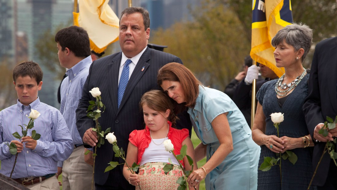 Christie and his family lay white roses on wreckage pulled from Ground Zero during the dedication of the Empty Sky Memorial for 9/11 at Liberty State Park in Jersey City, New Jersey, on September 10, 2011.