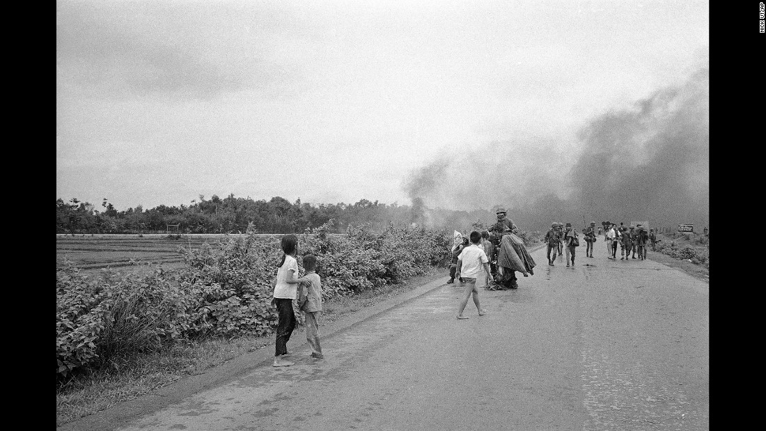 Injured civilians and soldiers flee from the site of the attack.