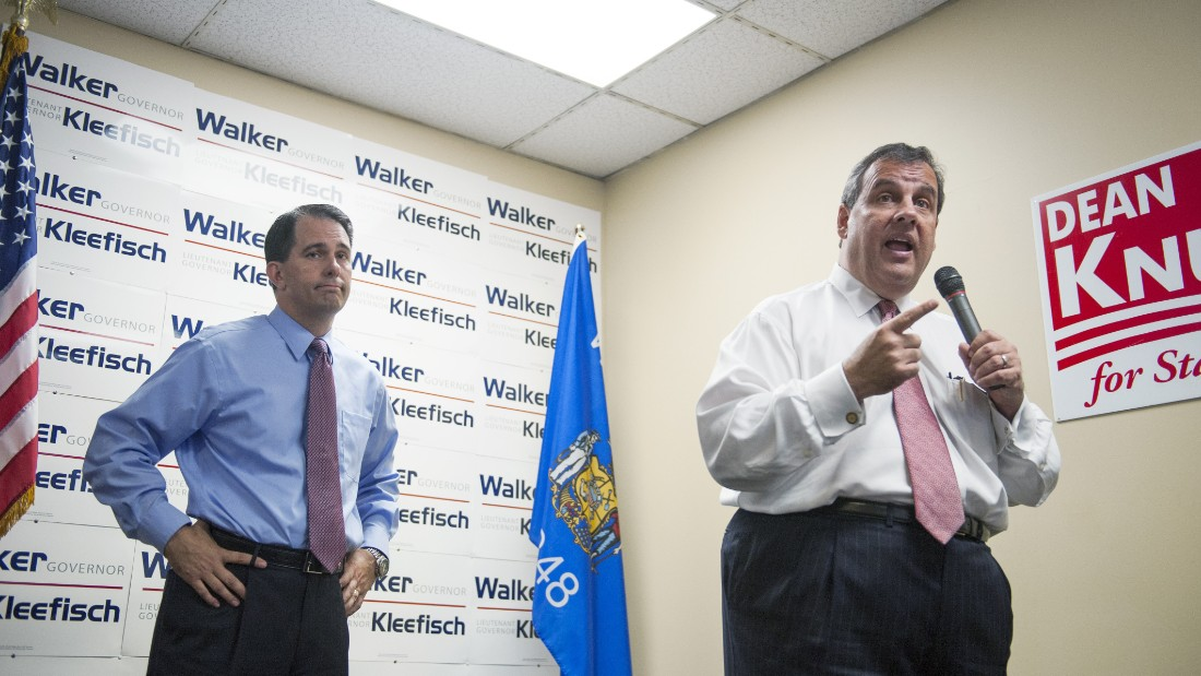Christie campaigns for Wisconsin Gov. Scott Walker during a stop at the GOP field office in Hudson, Wisconsin, in September 2014.