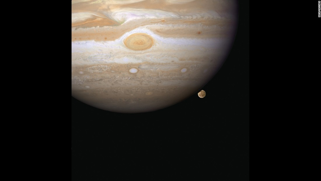 Hubble snapped this image in 2007 of Ganymede appearing to peek out from beneath Jupiter. Ganymede is the largest moon in our solar system and it's even bigger than Mercury.