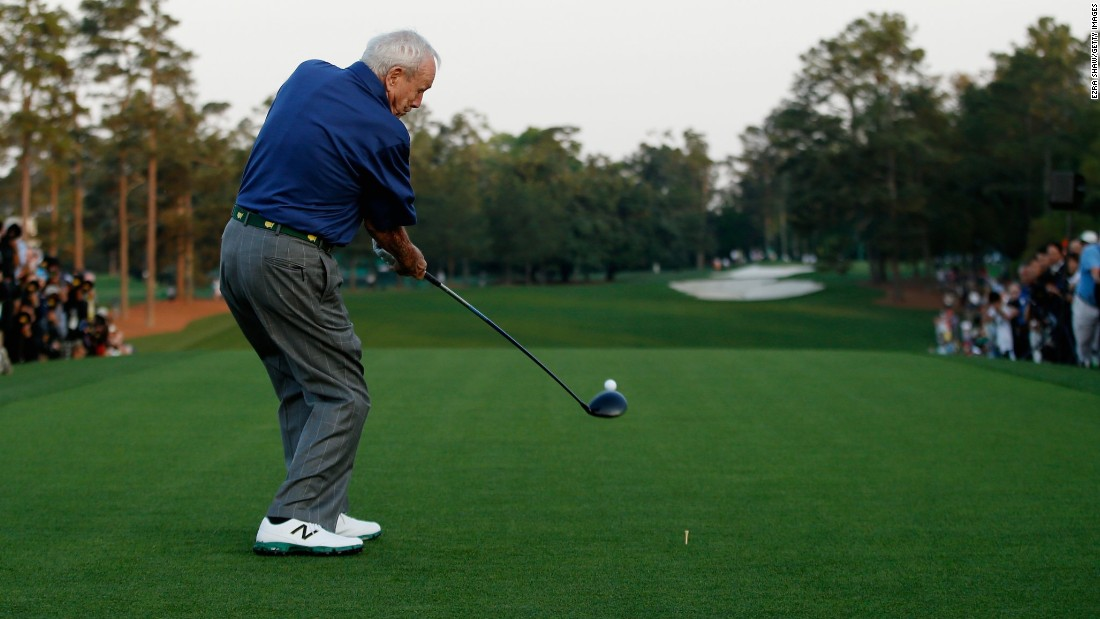 Four-time Masters winner Arnold Palmer, one of three honorary starters, hits his ceremonial tee shot at the first hole.
