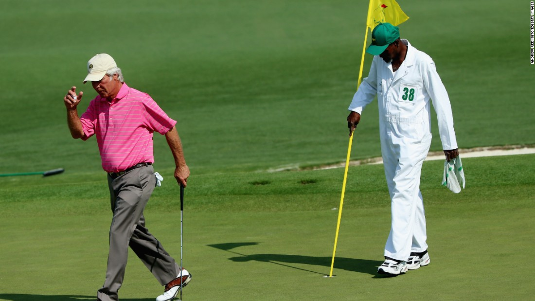 Two-time Masters winner Ben Crenshaw acknowledges the crowd during his final appearance at Augusta. The 63-year-old's longtime Augusta caddy Carl Jackson is at his 53rd and last Masters, having been on the bag with Crenshaw at the tournament since 1976. Crenshaw shot 19-over 91 -- four off the worst in this major.