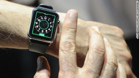 An Apple employee demonstrates how to use an Apple Watch during an Apple media event at the Yerba Buena Center for the Arts in San Francisco, California on March 09, 2015. AFP PHOTO / JOSH EDELSON (Photo credit should read Josh Edelson/AFP/Getty Images)