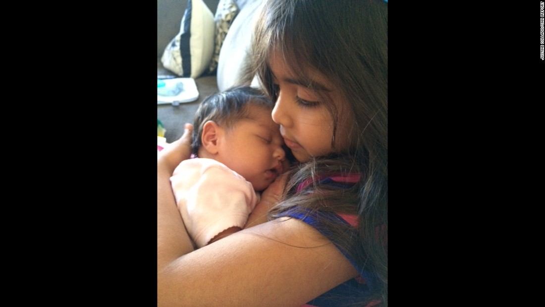 """Josie was so proud to be this baby's big sister. She stared at her and held her like she never wanted to let go."" -- <a href=""http://ireport.cnn.com/docs/DOC-1231979"">Justine Collado</a>, Prince William County, Virginia"