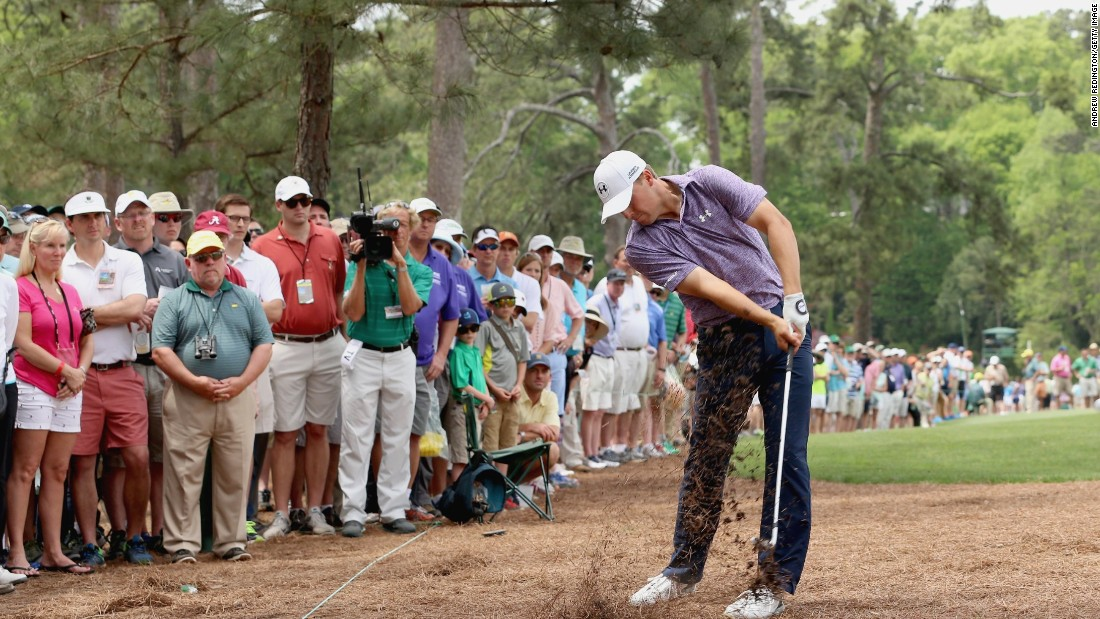 Jordan Spieth shooting from the 14th hole during the second round of the Masters on Friday. The 21-year-old broke the Masters record for the tournament halfway mark, finishing 14 under par.