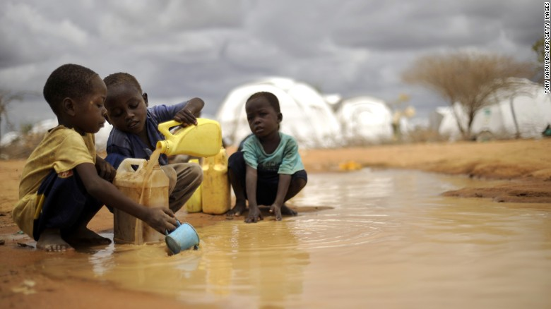 (FILES) This file picture taken on October 16, 2011, shows Somali boys fetching water from a puddle that formed after rain at the IFO-2 complex in the sprawling Dadaab refugee complex in Kenya.  Some 60 cases of cholera have been reported among Somali refugees in Kenay's giant Dadaab refugee camp, with at least one person dying from the disease, the UN Office of the High Commissioner for Human Rights said late on November 15, 2011. AFP PHOTO / TONY KARUMBA (Photo credit should read TONY KARUMBA/AFP/Getty Images)