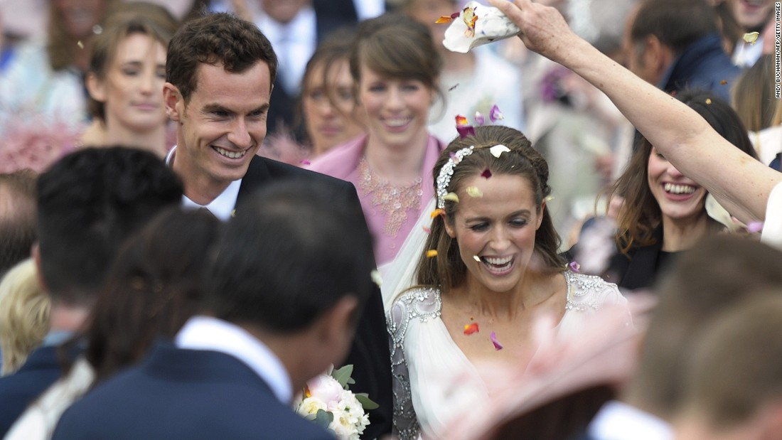 British tennis player Andy Murray and his new wife Kim Sears smile as they are showered in confetti after getting married at Dunblane Cathedral on April 11, 2015.