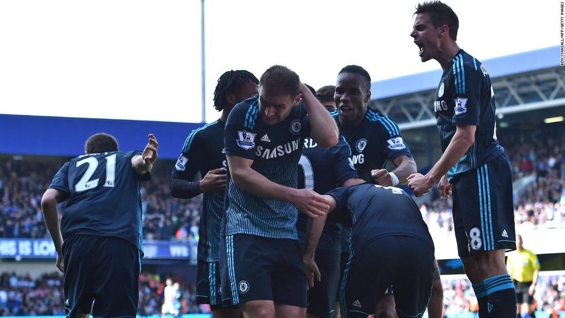 Chelsea's celebrations were met by a volley of missiles from the home fans. Branislav Ivanovic (center) complained of being hit by a coin.