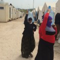 Yazidi refugee camp women water