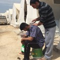 Yazidi refugee camp barber