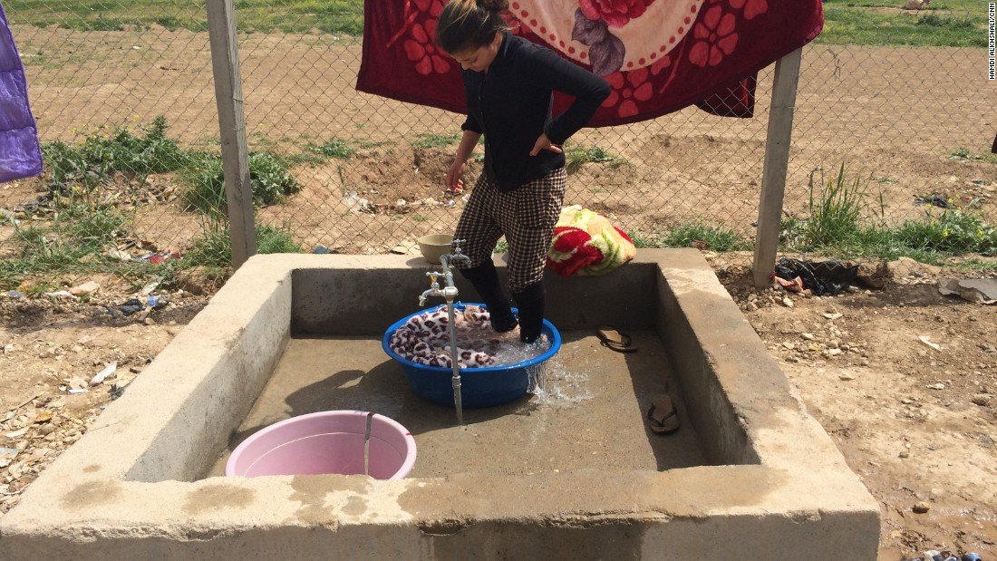 Amid all the uncertainty, a woman carries out domestic tasks. Yazidis are of Kurdish descent, and their religion is considered a pre-Islamic sect that draws from Christianity, Judaism and Zoroastrianism.
