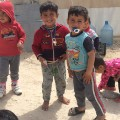 yazidi refugee camp boys smiling