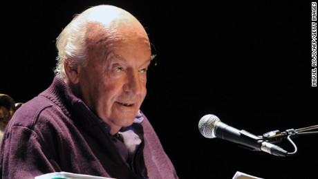 Uruguayan writer Eduardo Galeano reads from his new book 'Los hijos de los dias' (The sons of the days) at the Solis Theater in Montevideo on April 3, 2012. AFP PHOTO/Miguel ROJO (Photo credit should read MIGUEL ROJO/AFP/Getty Images)