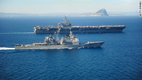 STRAIT OF GIBRALTAR - MARCH 31: In this handout provided by the U.S. Navy, the Ticonderoga-class guided missile cruiser USS Vicksburg (CG 69) escorts the Nimitz-class aircraft carrier USS Theodore Roosevelt (CVN 71) by the Rock of Gibraltar March 31, 2015 while transiting the Strait of Gibraltar. Theodore Roosevelt deployed from Norfolk and will execute a homeport shift to San Diego at the conclusion of deployment. Theodore Roosevelt is conducting naval operations in the U.S. 6th Fleet area of responsibility in support of U.S. national security interests in Europe. (Photo by Anthony Hopkins II/U.S. Navy via Getty Images