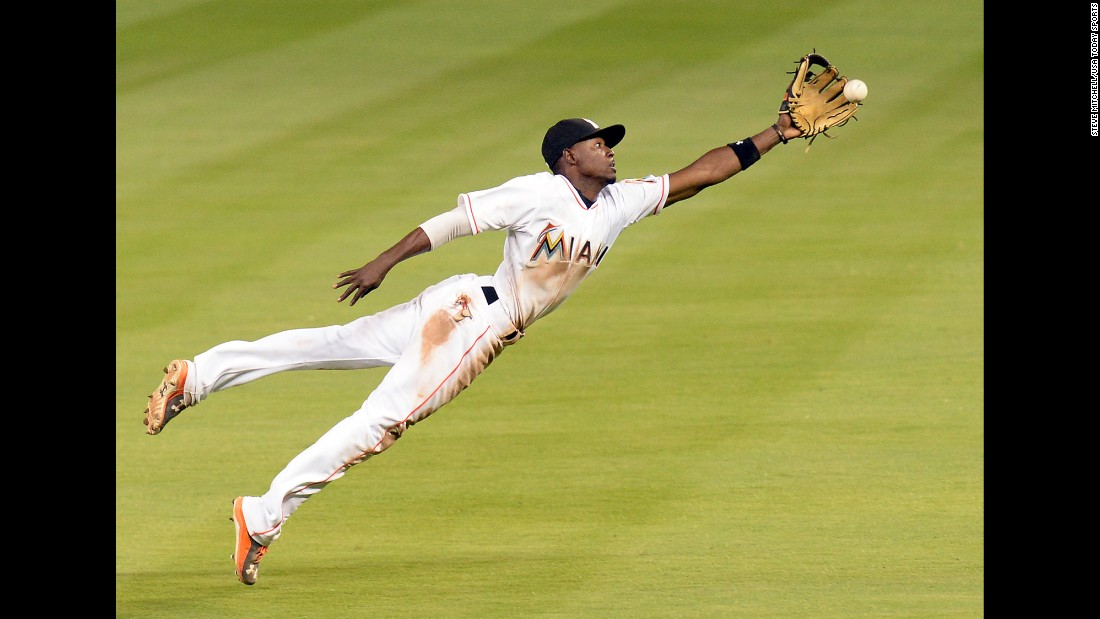 Miami Marlins second baseman Dee Gordon stretches out as he tries to make a catch Friday, April 10, during a home game against Tampa Bay.