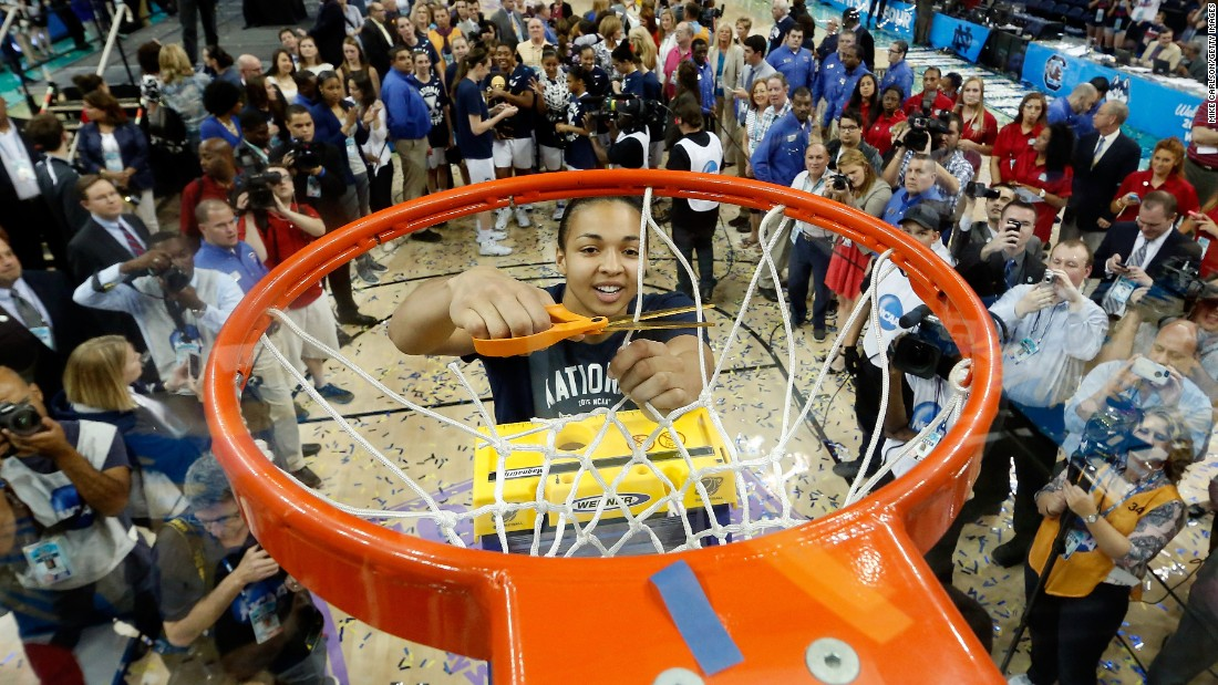 Connecticut's Kiah Stokes cuts a net in Tampa, Florida, after the Huskies defeated Notre Dame to win their third straight national title on Tuesday, April 7. UConn has now won 10 national championships since 1995, all under head coach Geno Auriemma.
