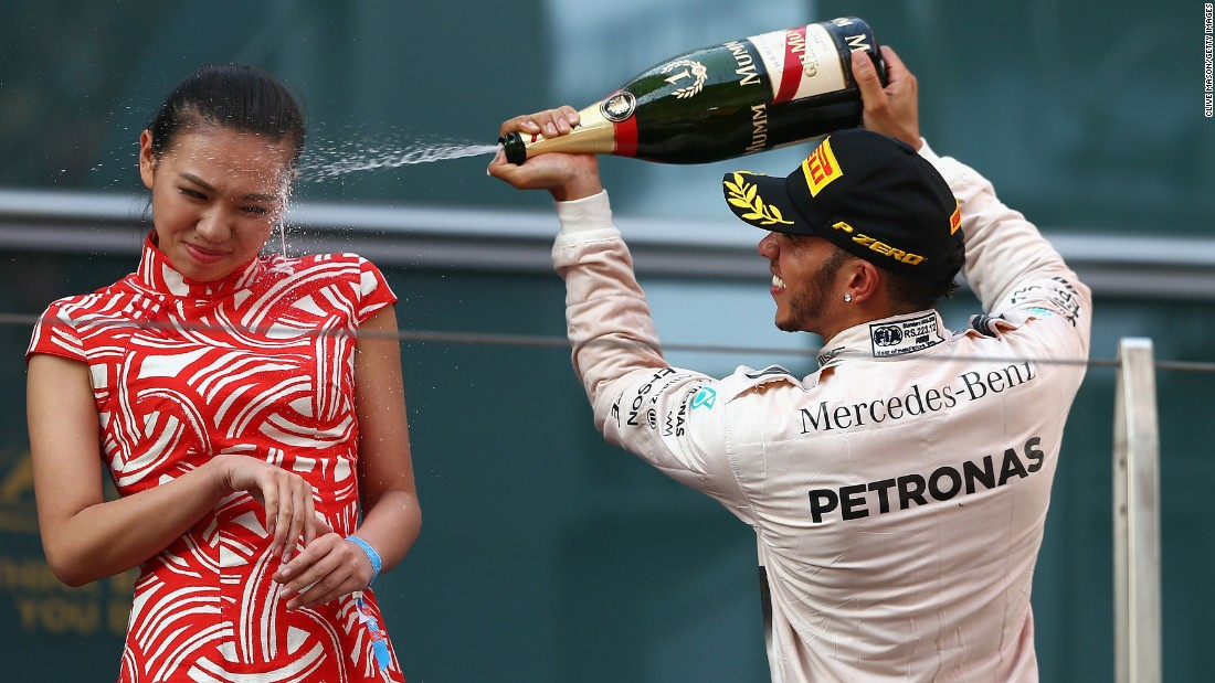 "Formula One driver Lewis Hamilton sprays a hostess with champagne after he won the Grand Prix of China on Sunday, April 12. Hamilton, the reigning F1 champion, <a href=""http://www.dailymail.co.uk/news/article-3037263/Stick-cork-Lewis-Formula-One-ace-Lewis-Hamilton-sprays-hostess-girl-face-champagne-winning-Chinese-Grand-Prix.html"" target=""_blank"">received some criticism</a> for spraying the woman, according to the Daily Mail."