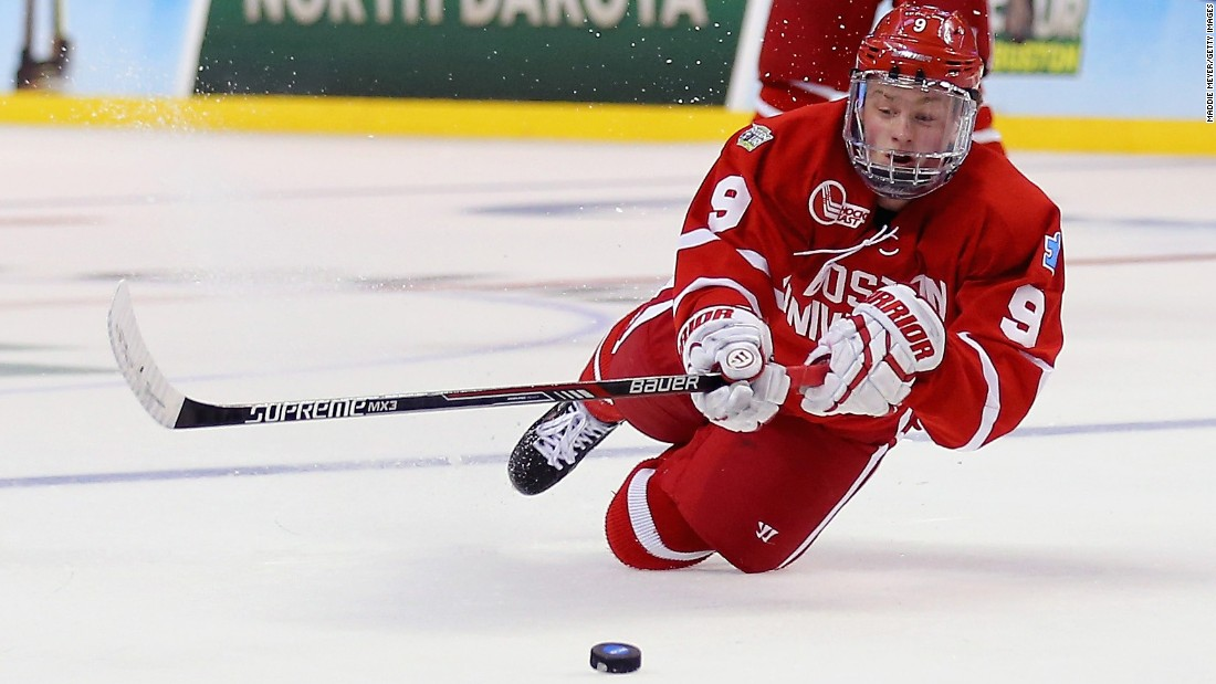 Jack Eichel of Boston University dives for the puck during the Frozen Four game against North Dakota on Thursday, April 9. Eichel, a freshman center, was this year's winner of the Hobey Baker Award, which is given to the nation's top collegiate player. He is widely expected to be one of the top picks in the next NHL draft.