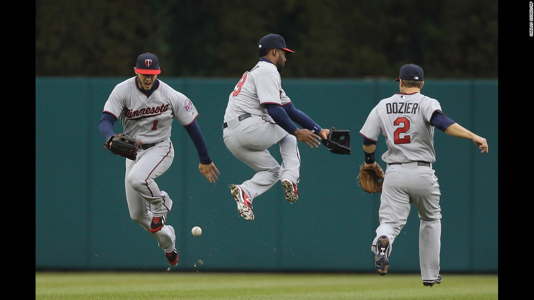 From left, Minnesota Twins center fielder Jordan Schafer, shortstop Danny Santana and second baseman Brian Dozier chase after a blooper during a game in Detroit on Thursday, April 9.