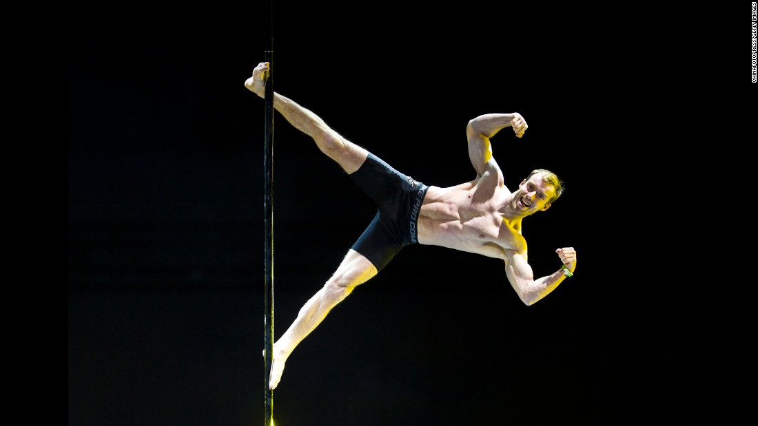 A competitor flexes Sunday, April 12, during the Pole Dancing World Championships in Beijing.
