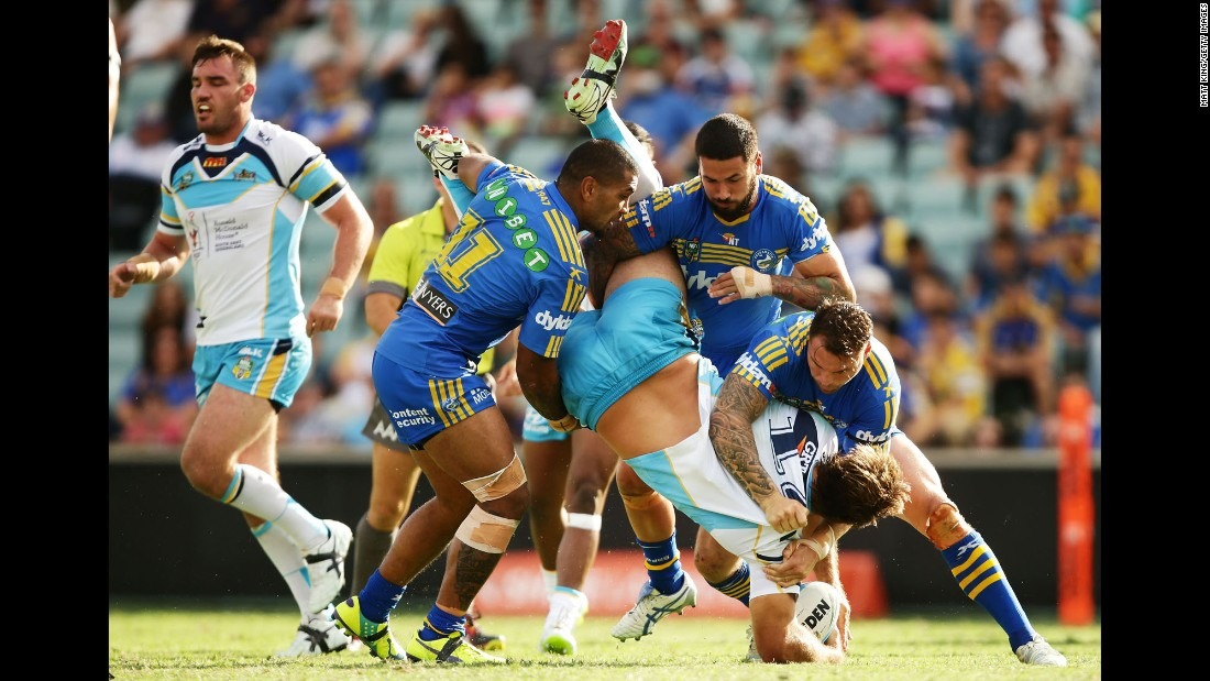 The Parramatta Eels tackle David Taylor of the Gold Coast Titans during a National Rugby League match Saturday, April 11, in Sydney.